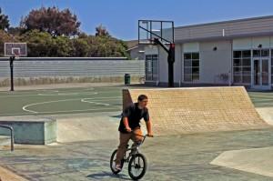 Skateboard park and basketball court near  recreation center at Leo Ryan Park