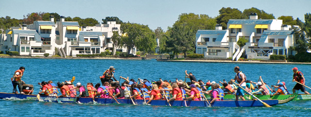 Dragon boat race on the lagoon. See the drummer in front & steersman in back.